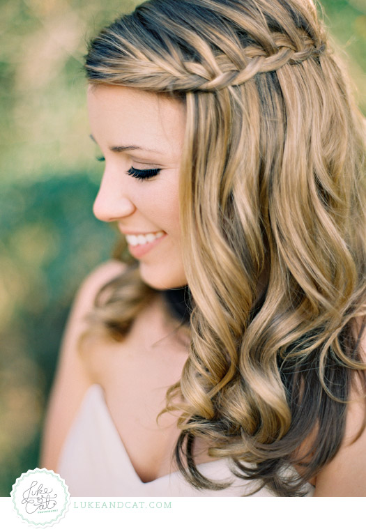 Closeup bridal portrait of bride with blonde hair and a waterfall braid.